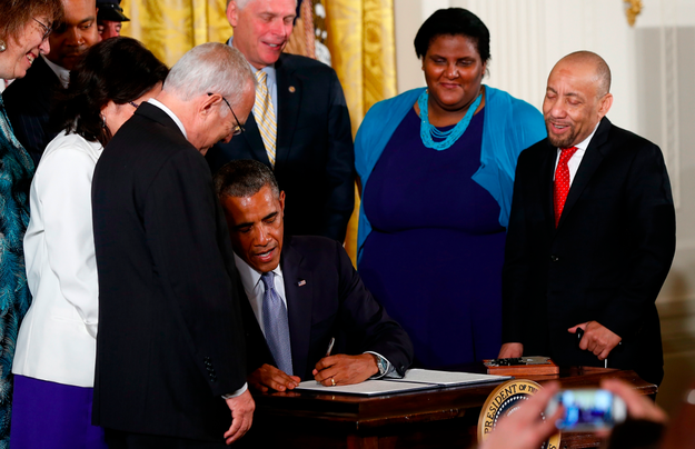 Kylar Broadus, right, was one of several people invited on stage with President Obama as he signed executive orders protecting LGBT workers earlier this year.